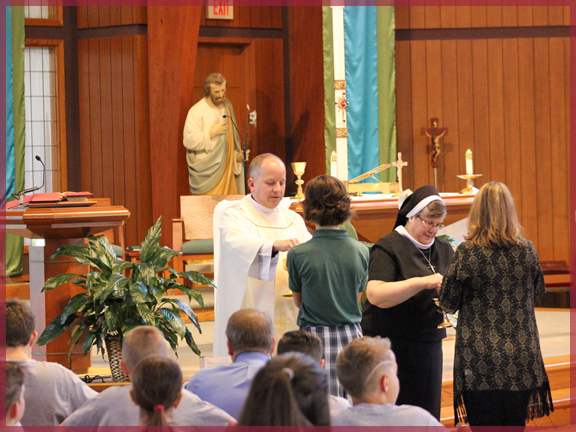 Fr. Shaughness and Sr. Carol distribute communion